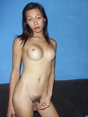 Long haired and busty dickgirl stripping and flashing her yummy genitals