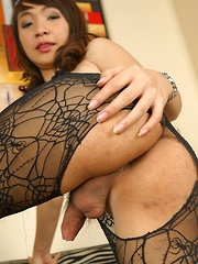 Tgirl Bell in Fishnet Catsuit