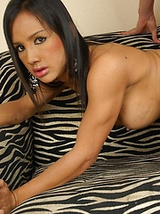 Gorgeous Asian shemale Lucky gets playing with her big tits while her man nibbles on her cock. They get into some hot do